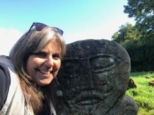 Mindie Burgoyne with Janus figure - Caldragh Cemetery